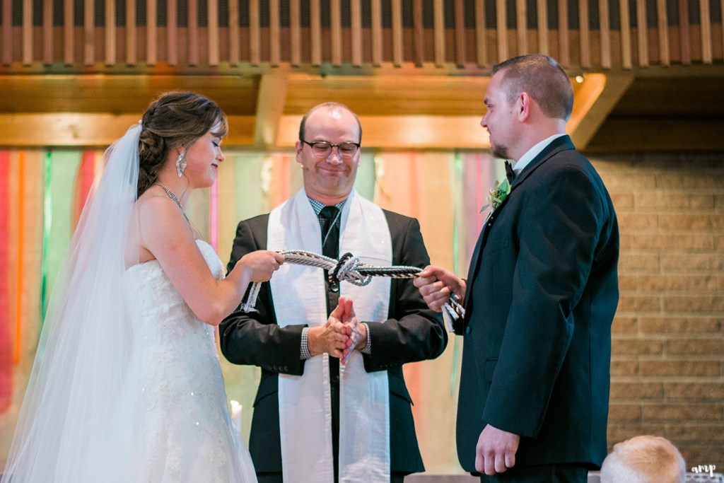 Bride and groom tie the knot in a handfasting ceremony