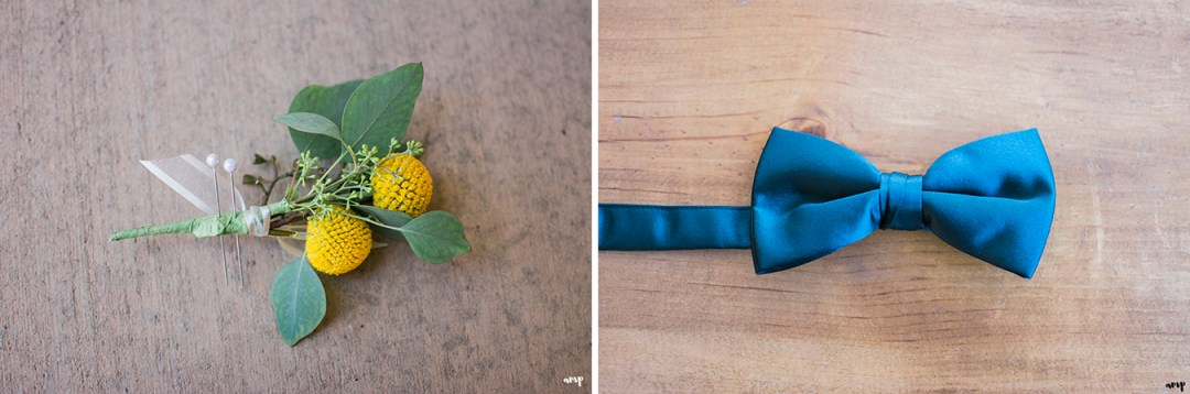 Groom's yellow boutonniere and bow tie