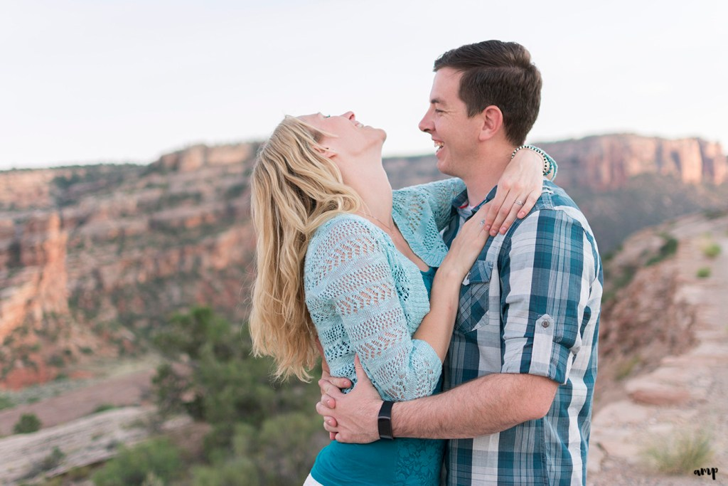 Couple laughing in the desert of the Colorado National Monument