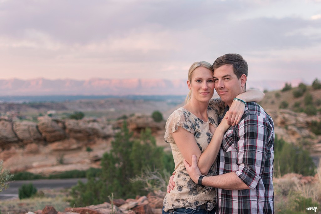 Couple cuddling in the desert of the Colorado National Monument