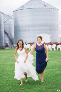 Bride and matron of honor walking to first look
