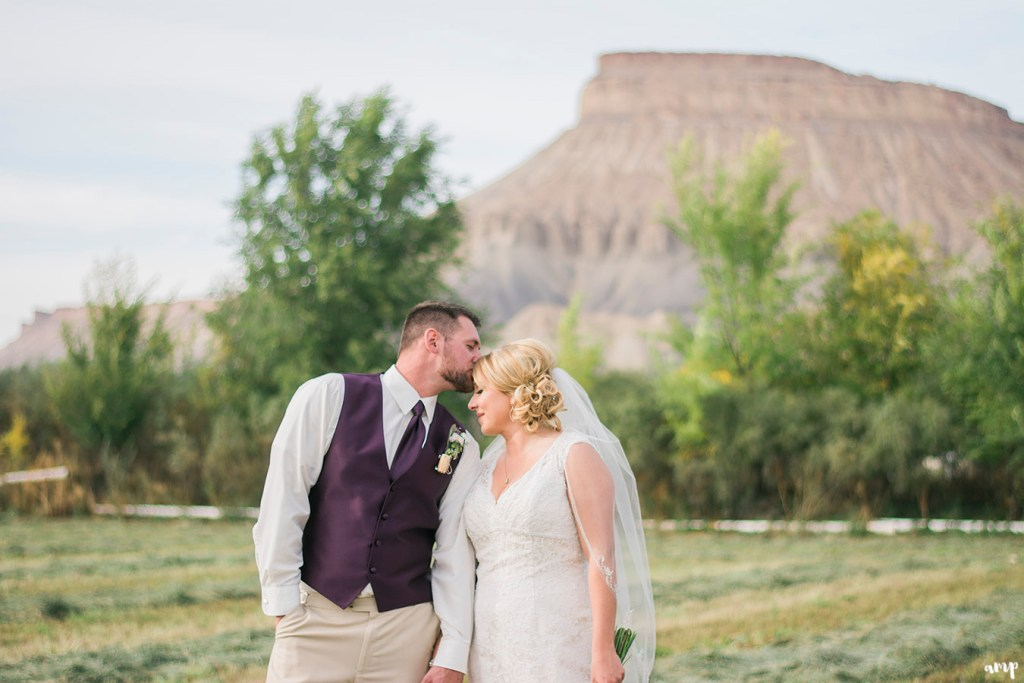 Bride and Groom posed beneath Mt. Garfield in Grand Junction