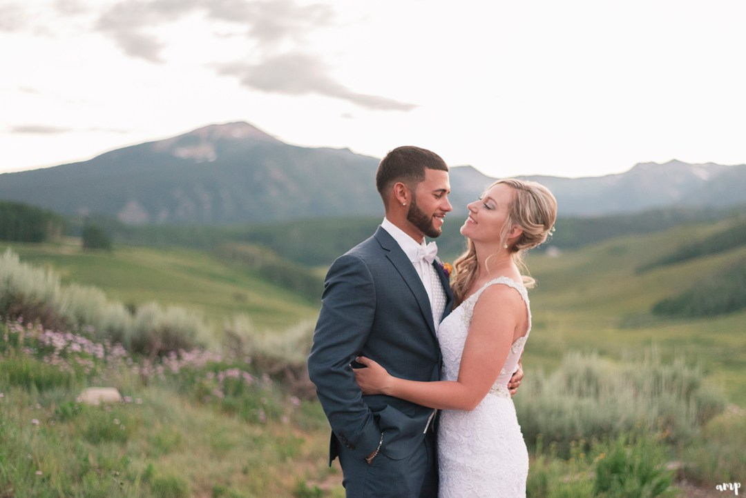 Bride and groom at sunset with mountains in the distance