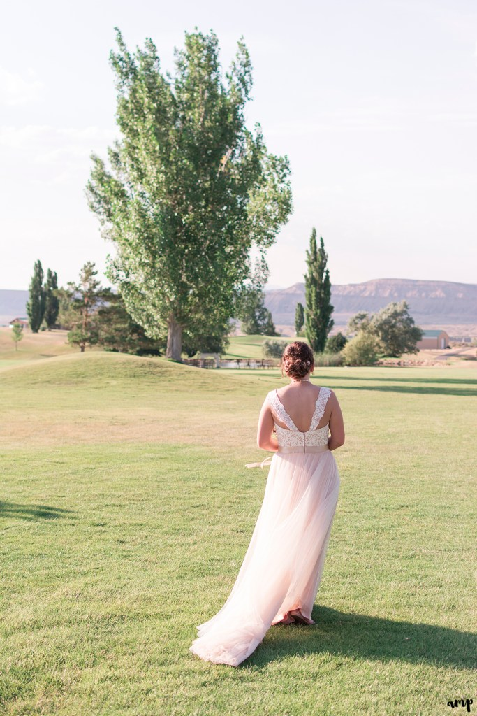 Bride walks into sunset as her tulle dress flows in the wind