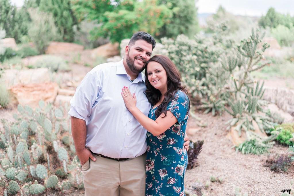 Engagement session couple in the desert garden of Montrose Botanic Center