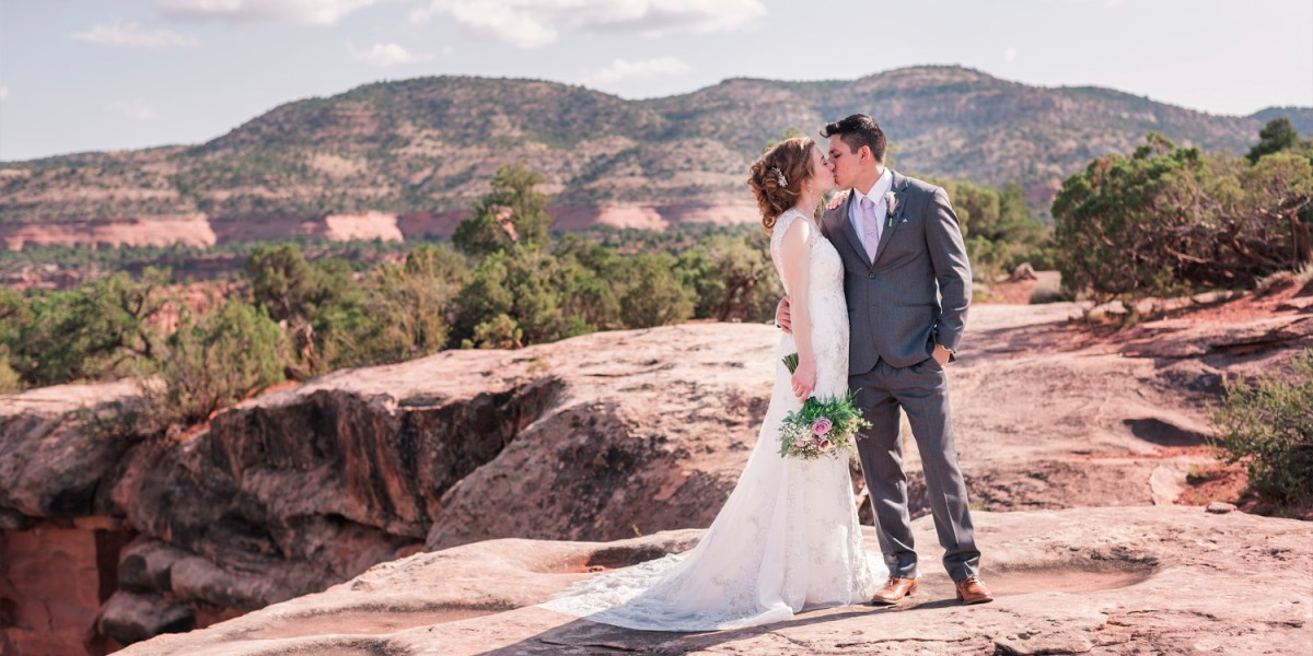 Bride and groom portraits on the Colorado National Monument | Grand Junction, CO wedding