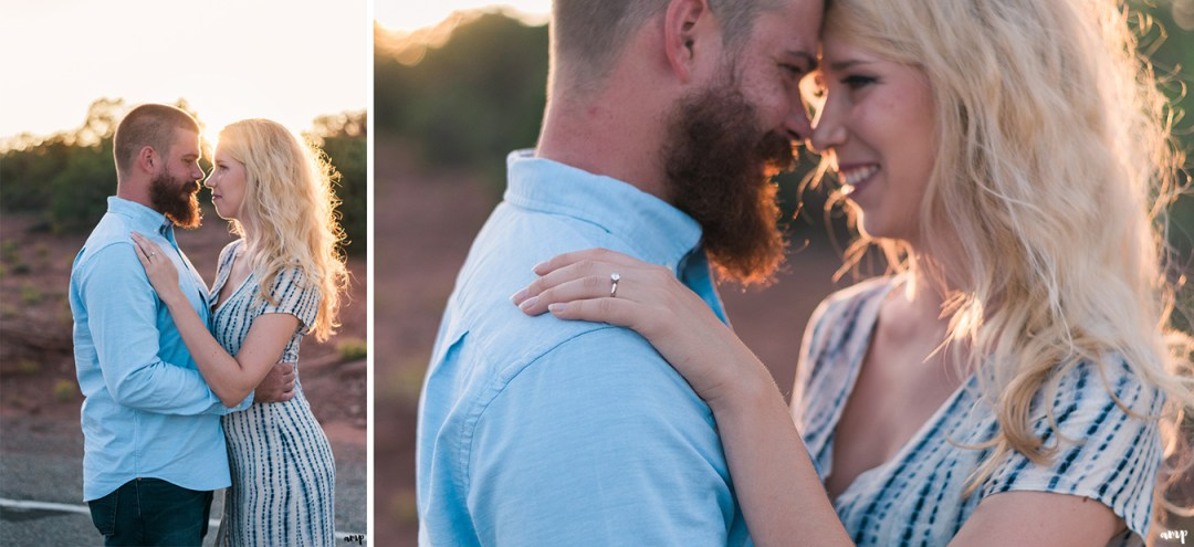 Engaged couple arm in arm as the sun sets behind them