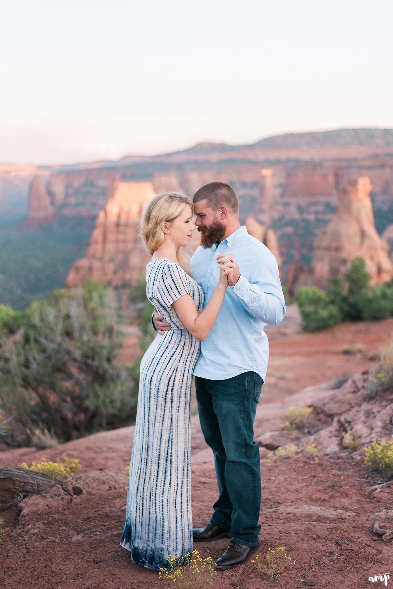 Engaged couple dances as the sun sets on the Colorado National Monument