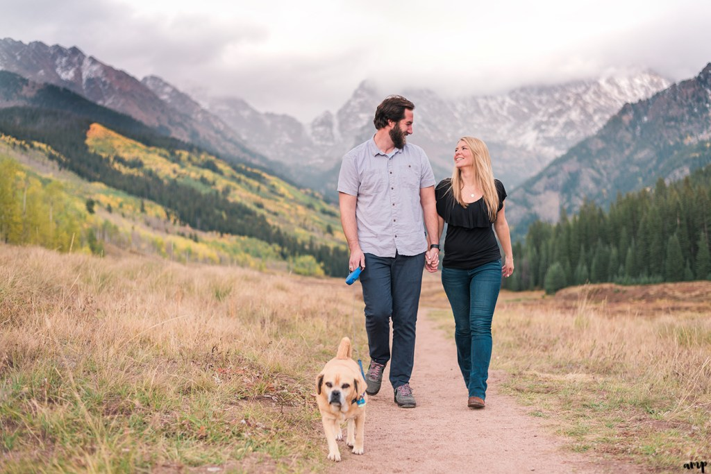 Couple walking their dog at Piney River Ranch