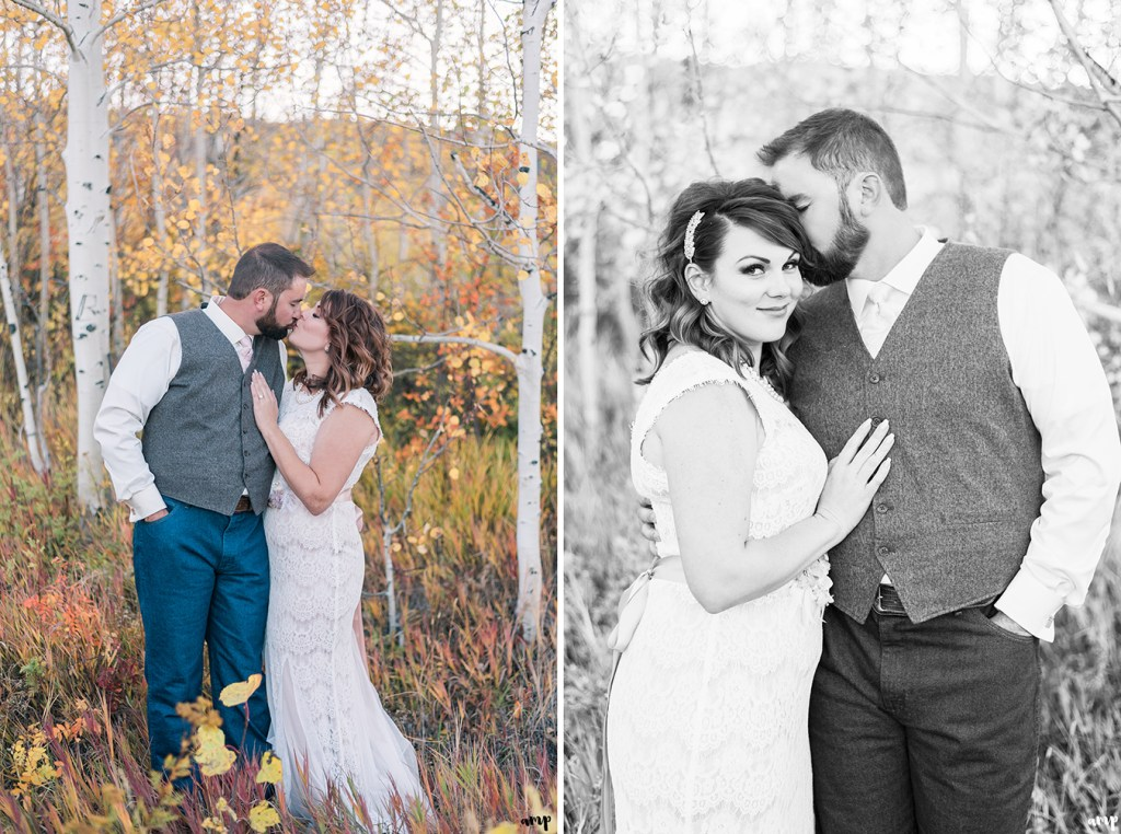 Bride and groom snuggle in a fall aspen grove