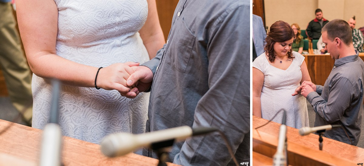 Couple exchange rings at their courthouse wedding in omaha