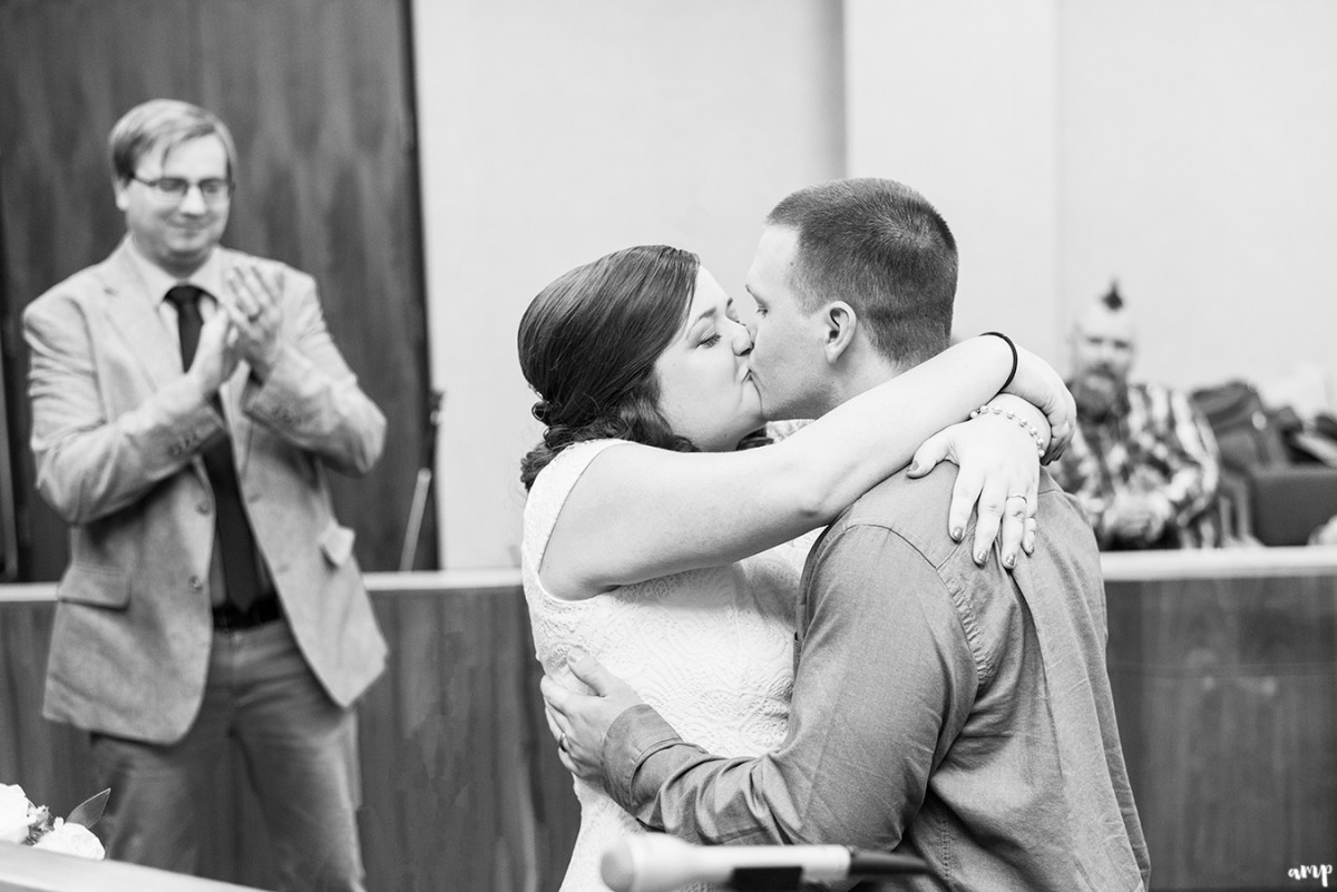 Couple kissing in the courthouse for their wedding in Omaha
