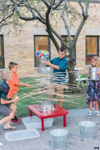 Kids play kerplunk yard games at a Grand Junction Wedding