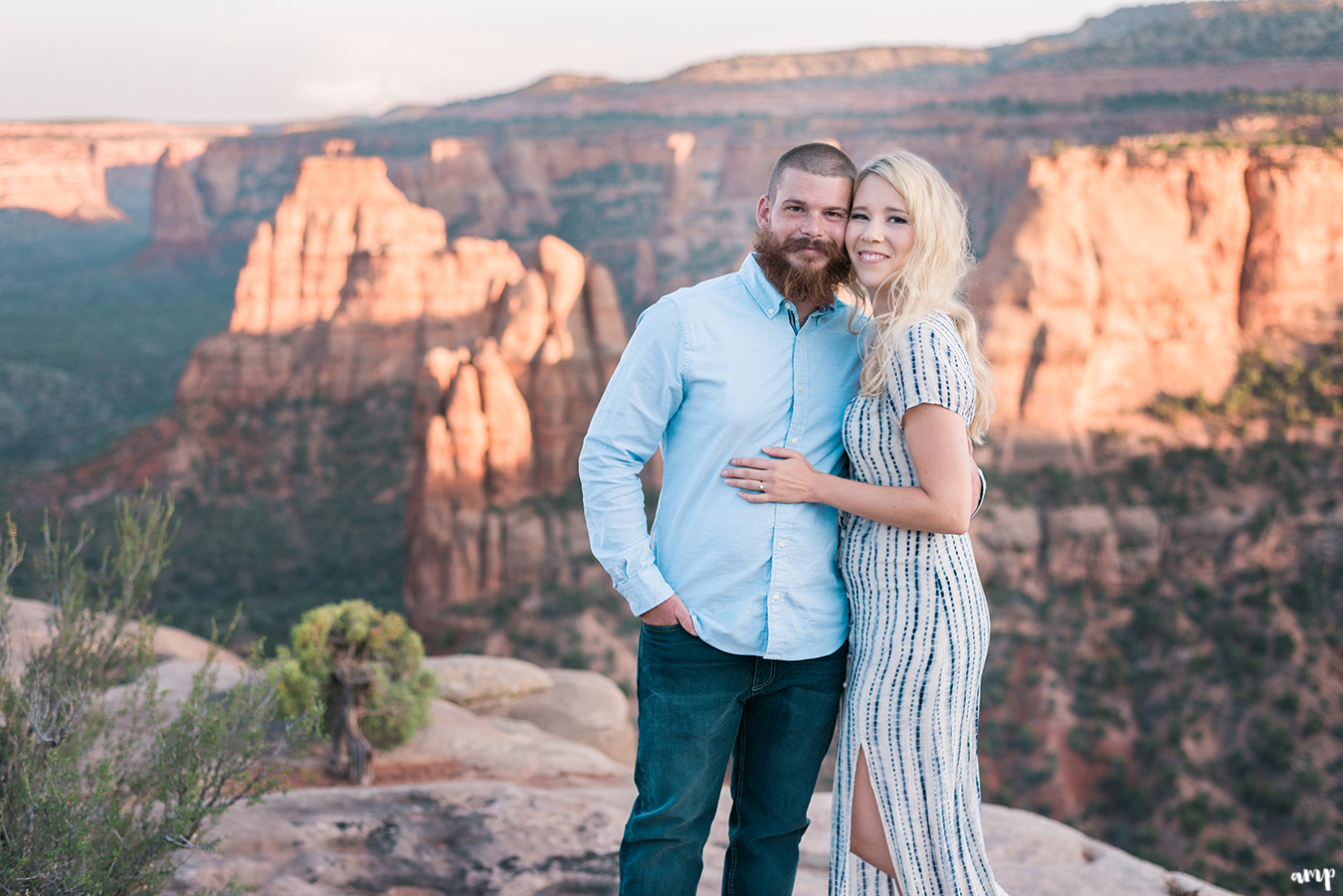 Engaged couple in the Colorado National Monument arm in arm