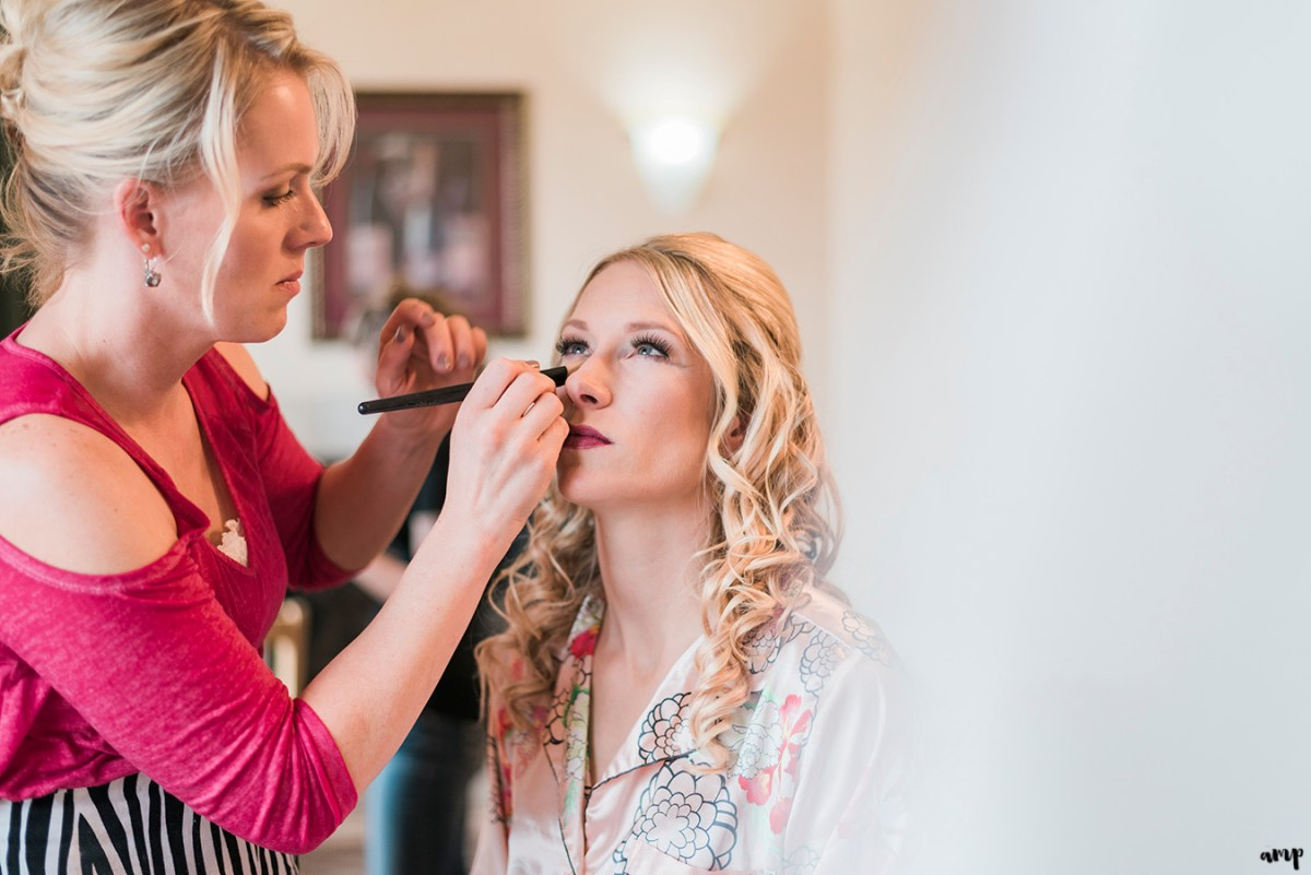 Bride getting her makeup done by All About Looks Image & Spa at Two Rivers Winery
