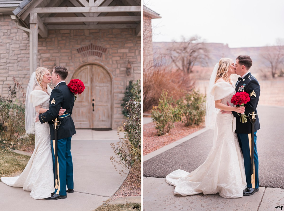 Couple embrace in front of the doorway of the vineyard at Two Rivers Winery
