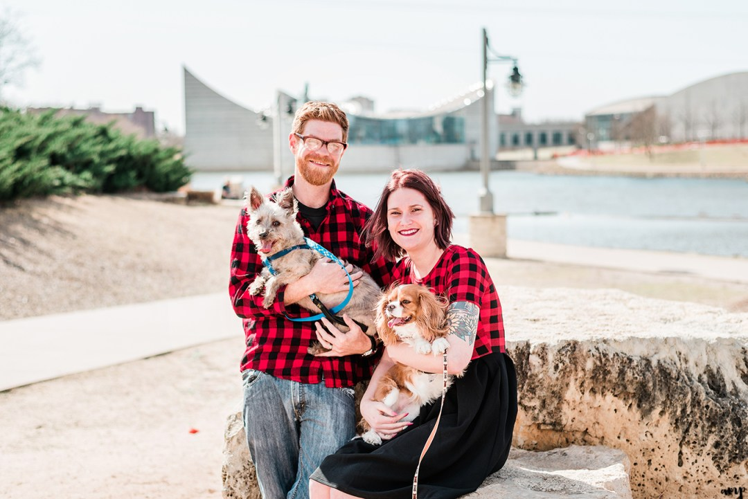 Ben and Courtnee walking their dogs along the riverfront