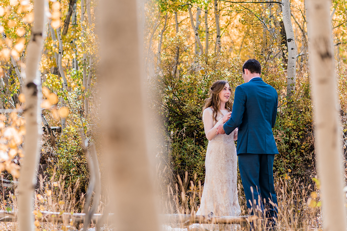 Couple exchanging private vows at Woods Walk in Crested Butte