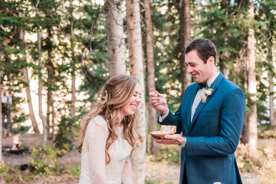 William & Amy cutting the cake at their Lake Irwin Wedding in Crested Butte