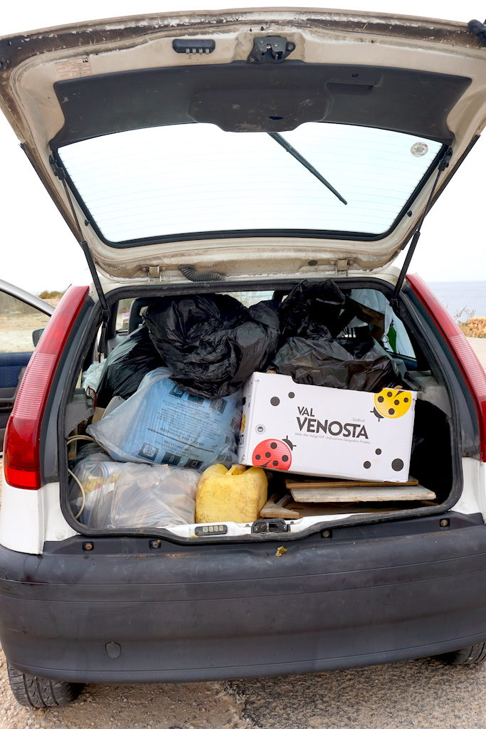 Car boot filled with trash collected at a coastal cleanup
