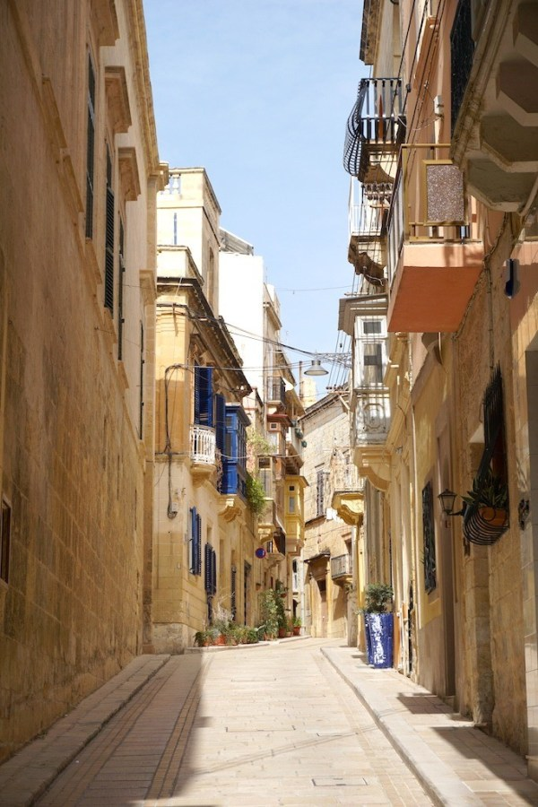 Beautiful balconies overhead on the streets of the Three Cities in Malta