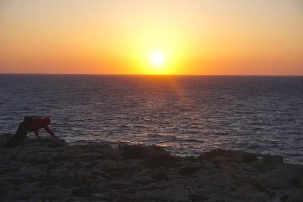 sunset over the fallen Azure Window in Gozo