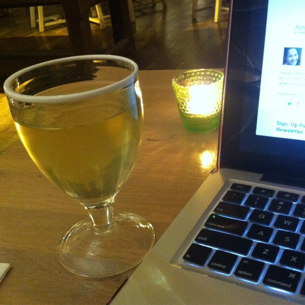 Working as a freelance writer with a glass of wine