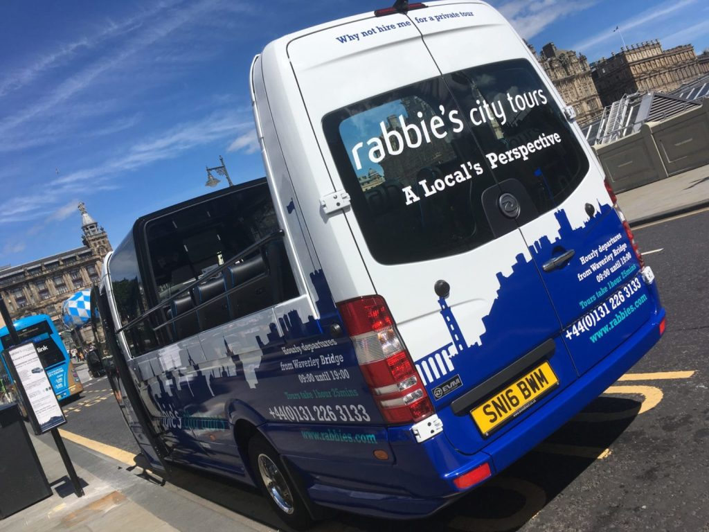 Rabbie's Edinburgh city tour bus with an open rooftop