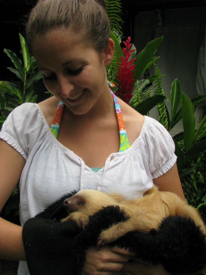 Amanda Walkins holding a baby sloth at a rescue center in Costa Rica