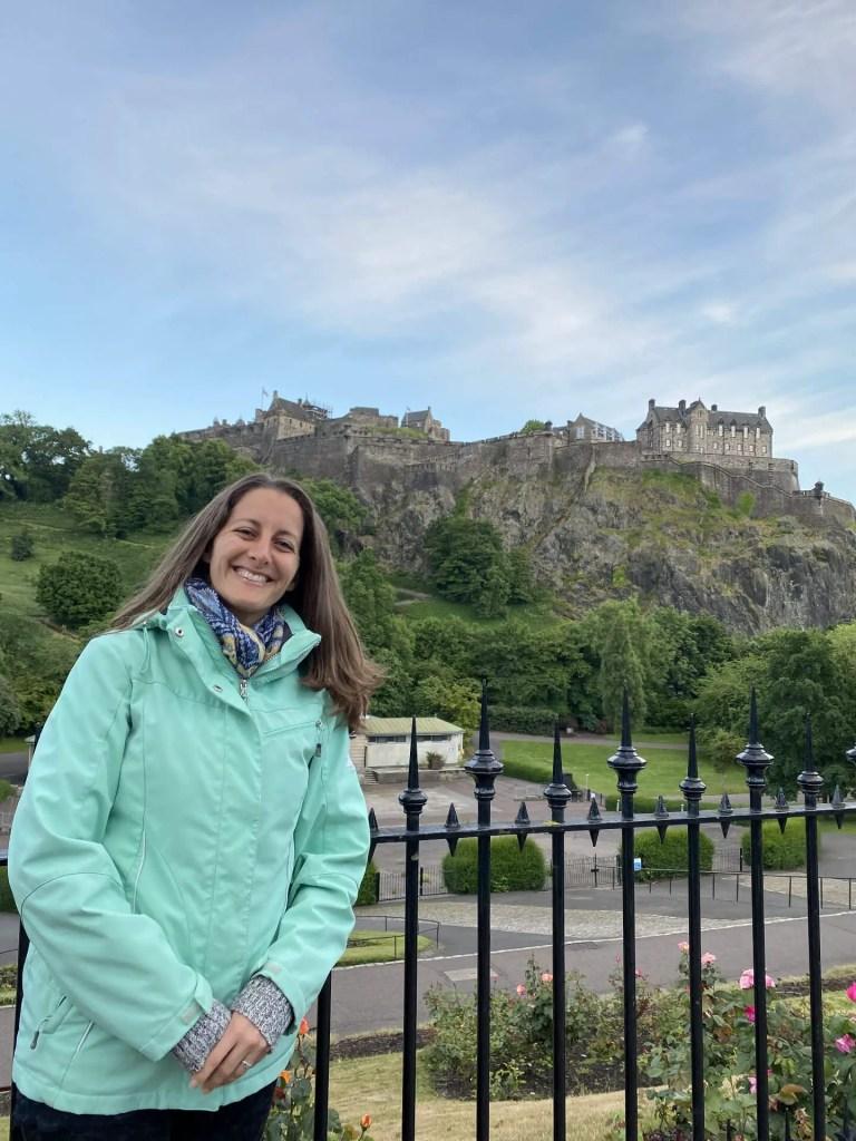 Amanda Walkins posing in front of Edinburgh Castle