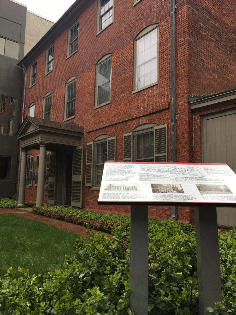 Henry Wadsworth Longfellow house with an informational panel out front in Portland ME