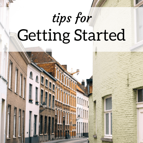 "Houses line a curved European street; Text reads ""Tips for Getting Started Housesitting"""
