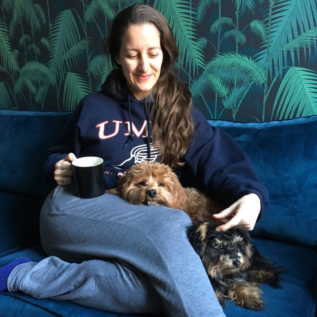 Amanda Walkins lessons learned house sitting with TrustedHousesitters 2 small dogs cuddling her on the couch