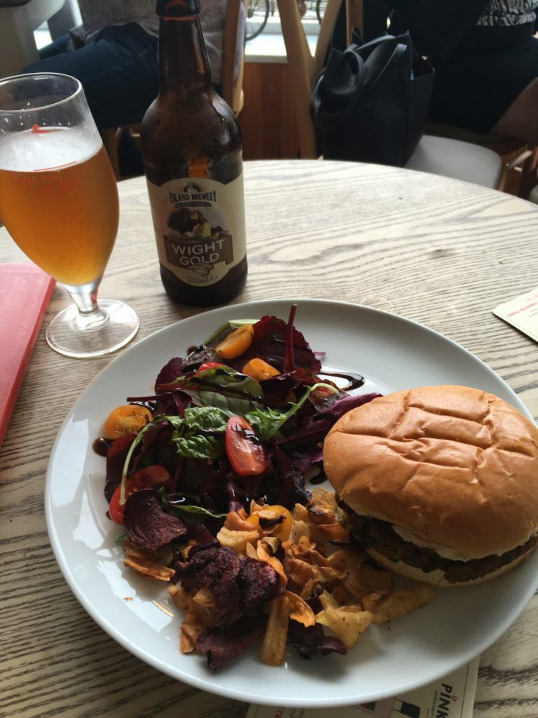 Lunch at Piano Cafe on the Isle of Wight - glass of local beer with a vegetarian burger, chips, and a salad