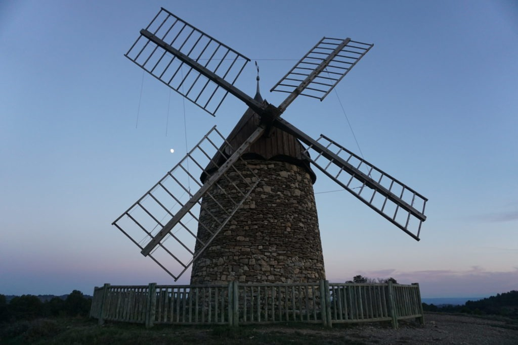 traditional wooden and stone windmill in southern France