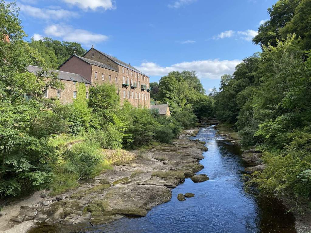 An old mill building rests along the river in Blairgowrie, Scotland