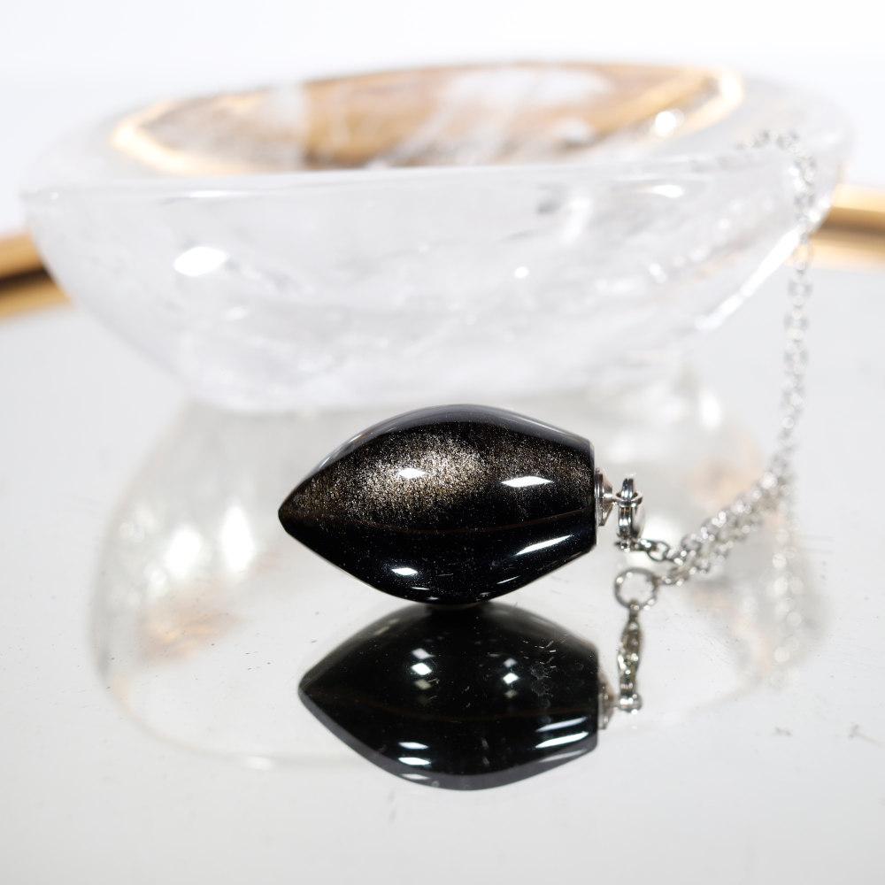 Pendule obsidienne dorée
