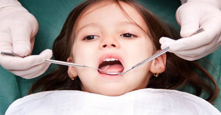 พาลูกหาหมอฟัน