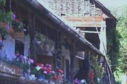 An elderly crofter's flowery verandah and wattle barn, near Aggtelek