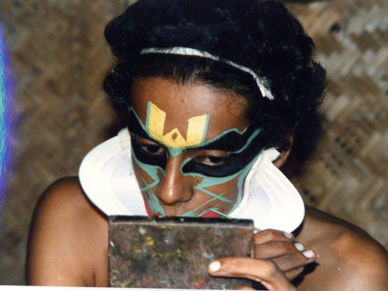 Kathakali performer engaged in make-up. S India
