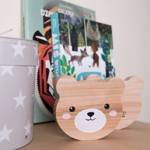 Shake up baby's playtime with the Bear Wood Toy, created especially for clutching hands and curious mind.