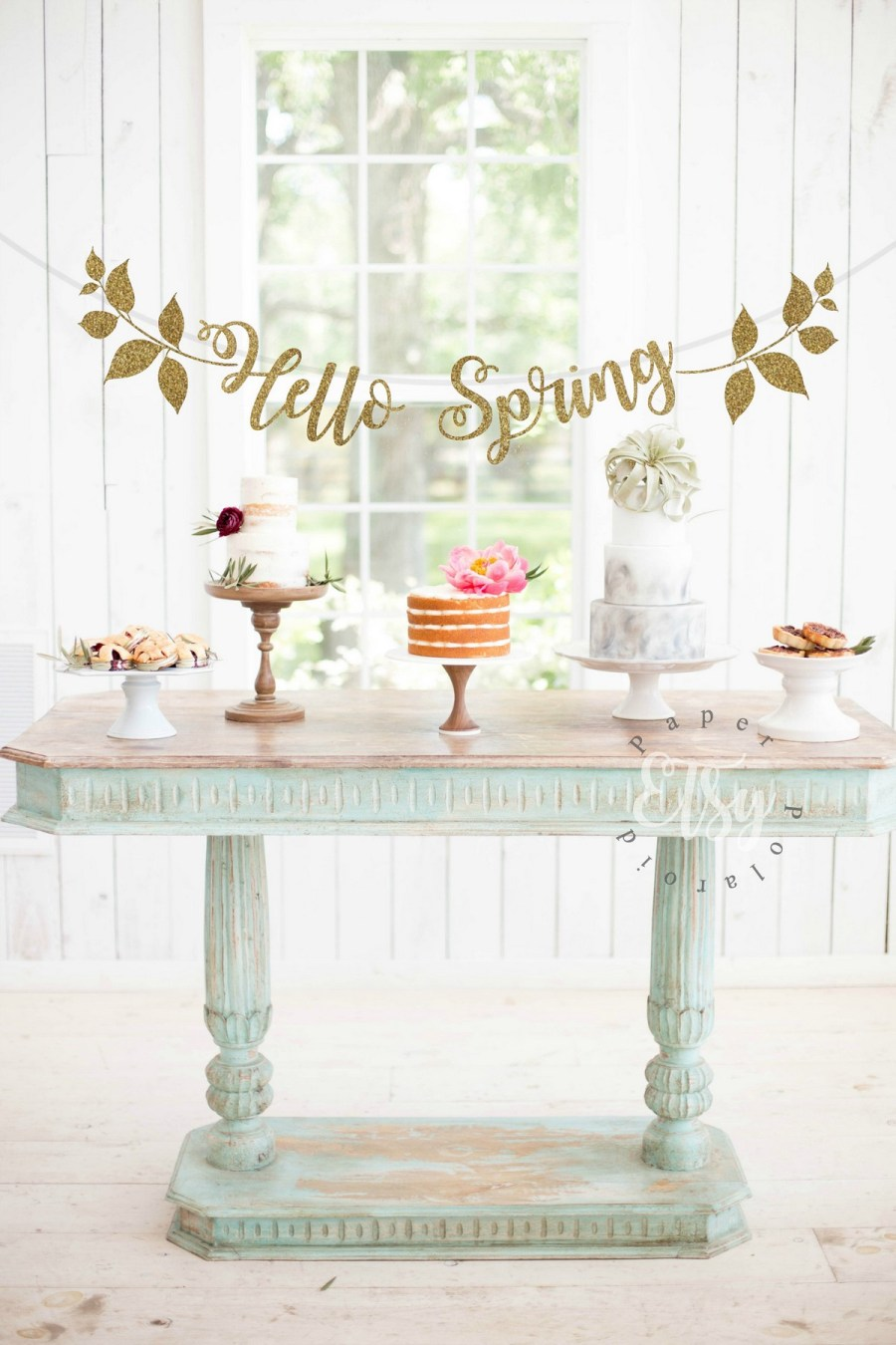 Whether hung over a door, draped over a mantel, or showcased at a backyard BBQ, spring garlands need to make an appearance this season.