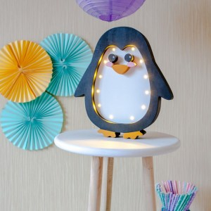 Perfect for setting a calm moon in your kid's bedroom, the Penguin Decorative Night Light gives a soft glow when turned on.