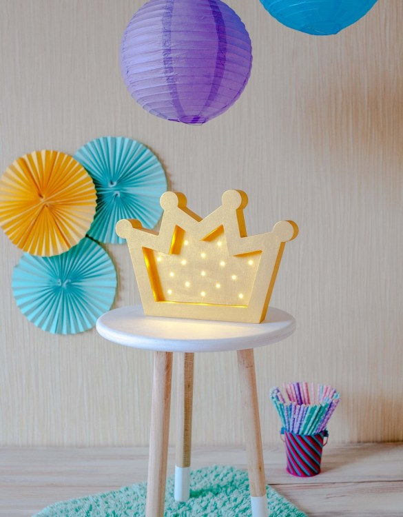 Perfect for setting a calm moon in your kid's bedroom, the Crown Decorative Night Light gives a soft glow when turned on.