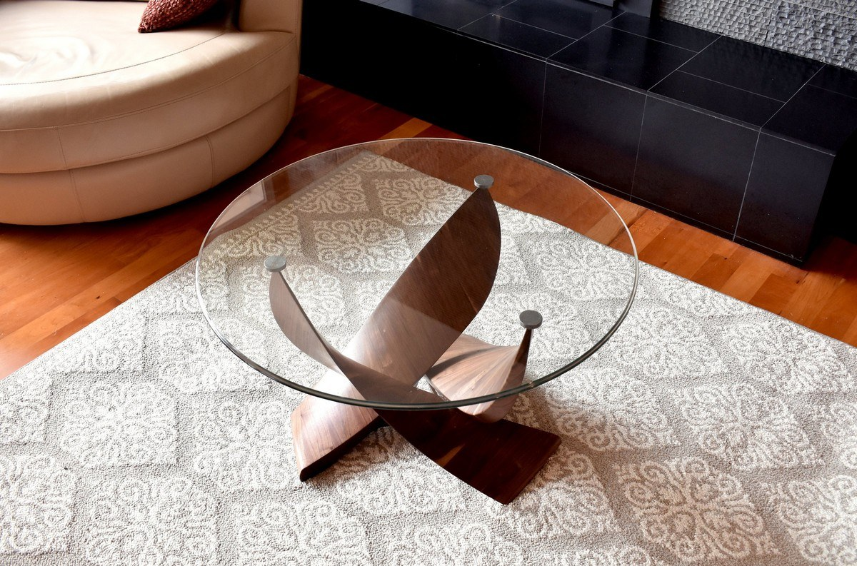 Modern coffee tables are of many different types, with various shapes and can be made of a variety of materials so let's pick something specific to focus on: a round glass coffee table.