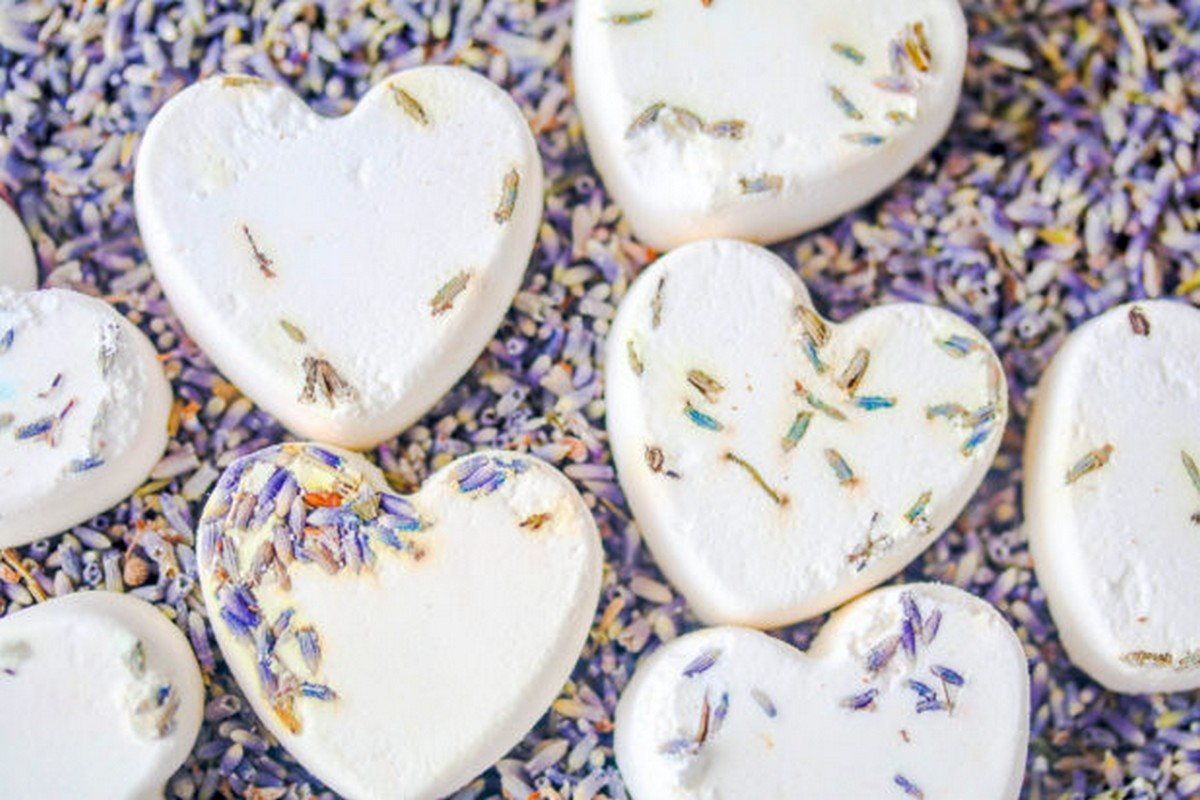 The skin-nourishing fats and oil in these DIY bath melts will partially mix with your bath water, but mainly float on top to soften your skin. To make these even more fun and luxurious, add dried botanicals and/or essential oils.