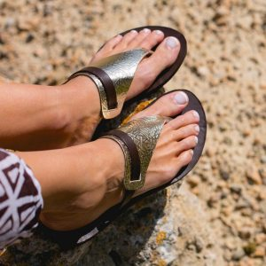 Just what every summer wardrobe needs, the Artemis Gold and Brown Greek Leather Sandal is every woman's dream pair, super comfy and elegant, and easily combined with any outfit.
