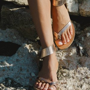 Just what every summer wardrobe needs, the Penelope Snake Rose Gold Greek Leather Sandal is every woman's dream pair, super comfy and elegant, and easily combined with any outfit.