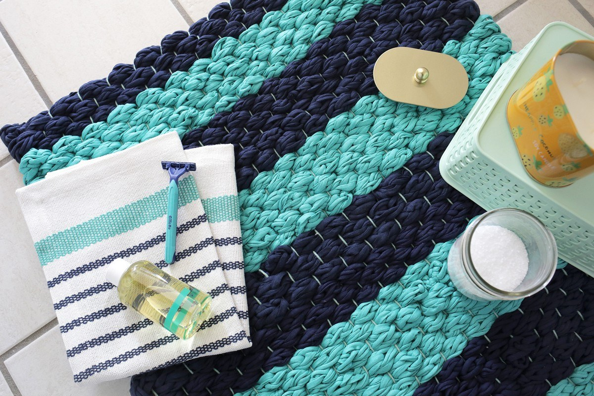 What's even more fun than crafting your own bath mats is making them from unconventional materials.