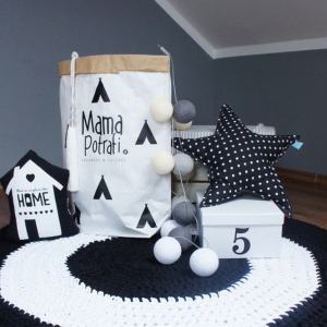 A one-of-a-kind addition to timeless interiors, the Black and White Children Crochet Rug offers a relaxed comfortable feel of elegance for the modern home.This nursery rug will stand out bold and bright against your floor and bring a quirky and charming vibe to your home.